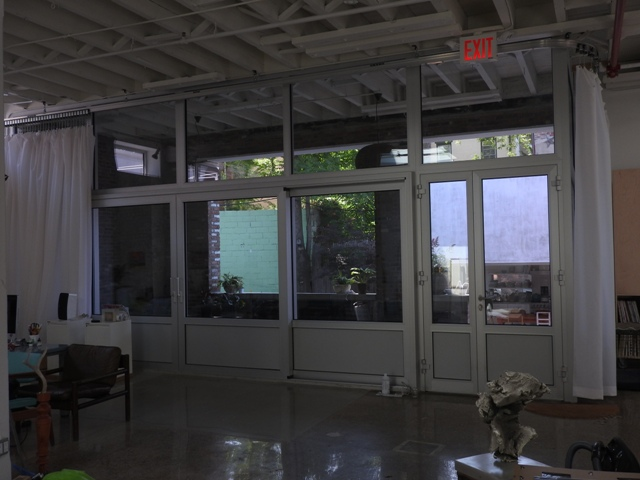 Security glass wall with sliding door