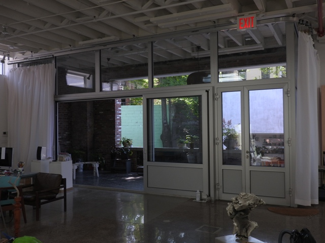 Impact resistant glass in glass wall
